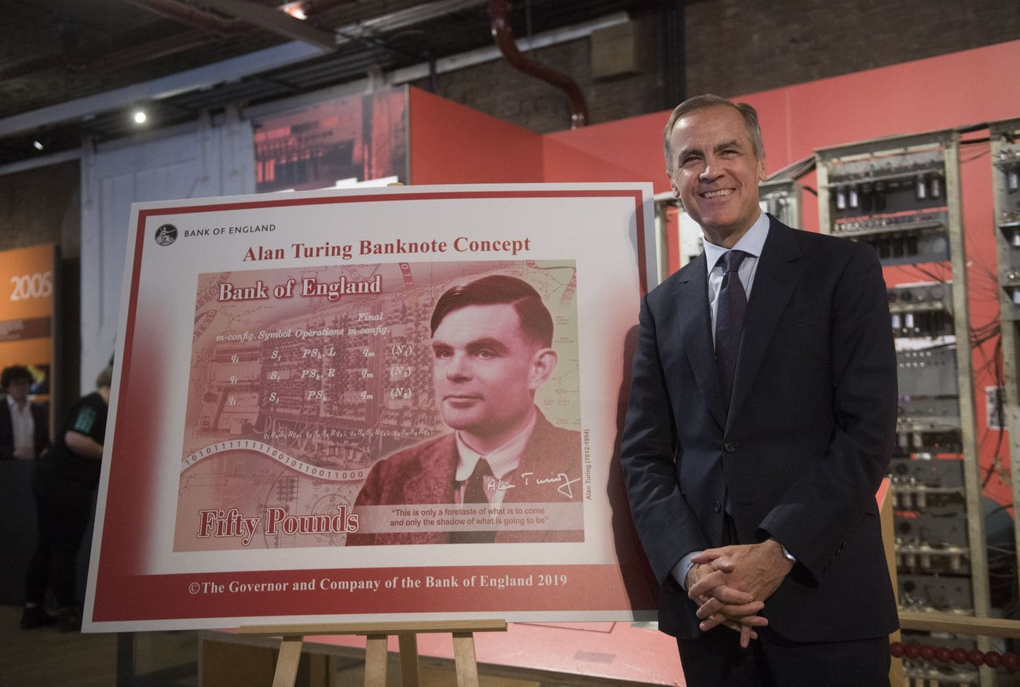 Mark Carney, governor of the Bank of England, presents a concept design following a news conference to announce that scientist Alan Turing will be displayed on the new 50-pound note in Manchester, U.K., on July 15. (Matthew Lloyd/Bloomberg)